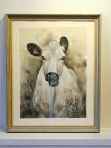 foto på tavla av en ko